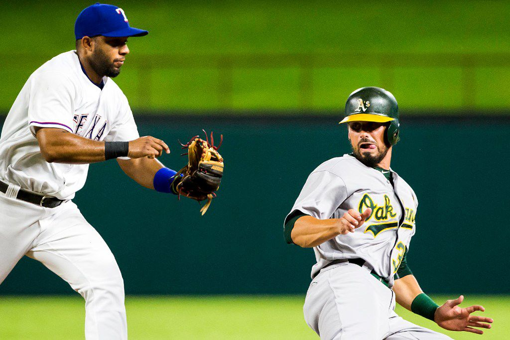 FILE - Rangers shortstop Elvis Andrus chases down Oakland Athletics outfielder Brett Eibner as he is caught in a rundown between first and second base during the fourth inning of a game on Friday, Sept. 16, 2016, at Globe Life Park in Arlington. (Smiley N. Pool/The Dallas Morning News)
