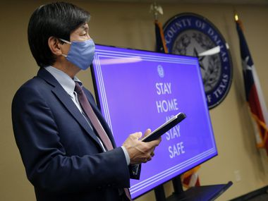 """""""I think simultaneously everyone thought things were open, now we can go back to normal,"""" Dallas County health director Philip Huang, shown at a June 19 news conference, said Thursday. """"And now three, four weeks out, this is where we're seeing the effects of that."""""""