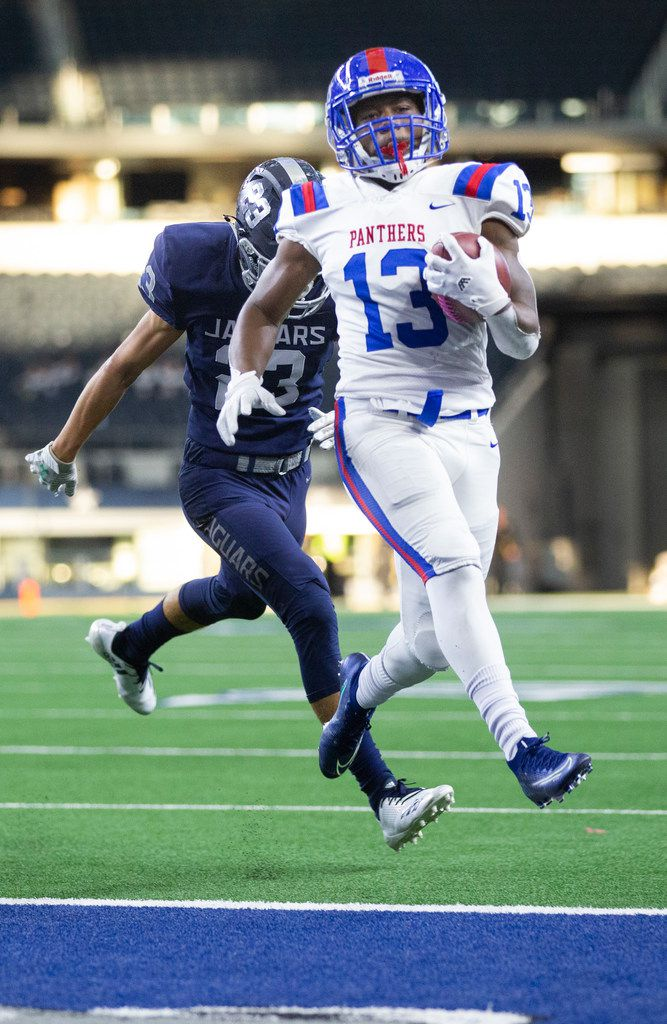 Duncanville wide receiver Roderick Daniels leaps into the endzone to score a touchdown against Flower Mound right before halftime begins during the a Class 6A Division I area-round high school football playoff game at the AT&T Stadium in Arlington, Texas, on Saturday, November 23, 2019. (Lynda M. Gonzalez/The Dallas Morning News)
