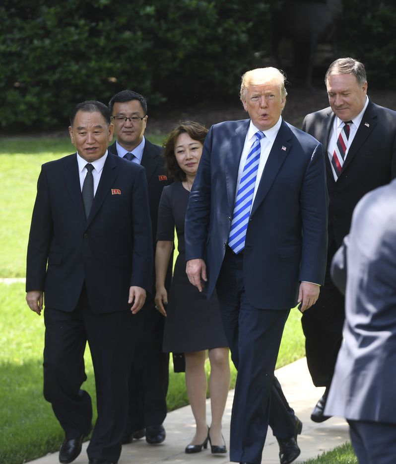 US President Donald Trump (C-R), flanked by US Secretary of State Mike Pompeo (R), walks with North Korean Kim Yong Chol (L) at the White House on June 1, 2018 in Washington,DC. North Korean dictator Kim Jong Un's right-hand man met with Trump to deliver a letter from his leader that could pave the way to a historic nuclear summit in Singapore.