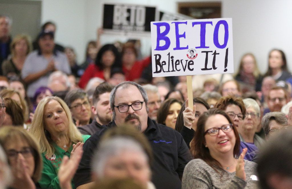 Supporters held up signs for El Paso Rep. Beto O'Rourke, who is challenging Ted Cruz for his Senate seat, at a town hall meeting at the Plumbers & Pipefitters Union Hall on West Miller Road in Garland on Jan. 26, 2018.