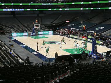 The Dallas Mavericks and Charlotte Hornets tip off as they play in the second quarter of play of the home opener at American Airlines Center on Wednesday, December 30, 2020 in Dallas. No fans were allowed in the arena for the game. (Vernon Bryant/The Dallas Morning News)