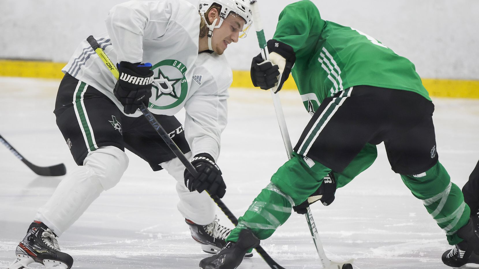 Dallas Stars centers Roope Hintz (left) and Joe Pavelski (right) set up for a face off during a training camp practice at the Comerica Center on Wednesday, Jan. 6, 2021, in Frisco.