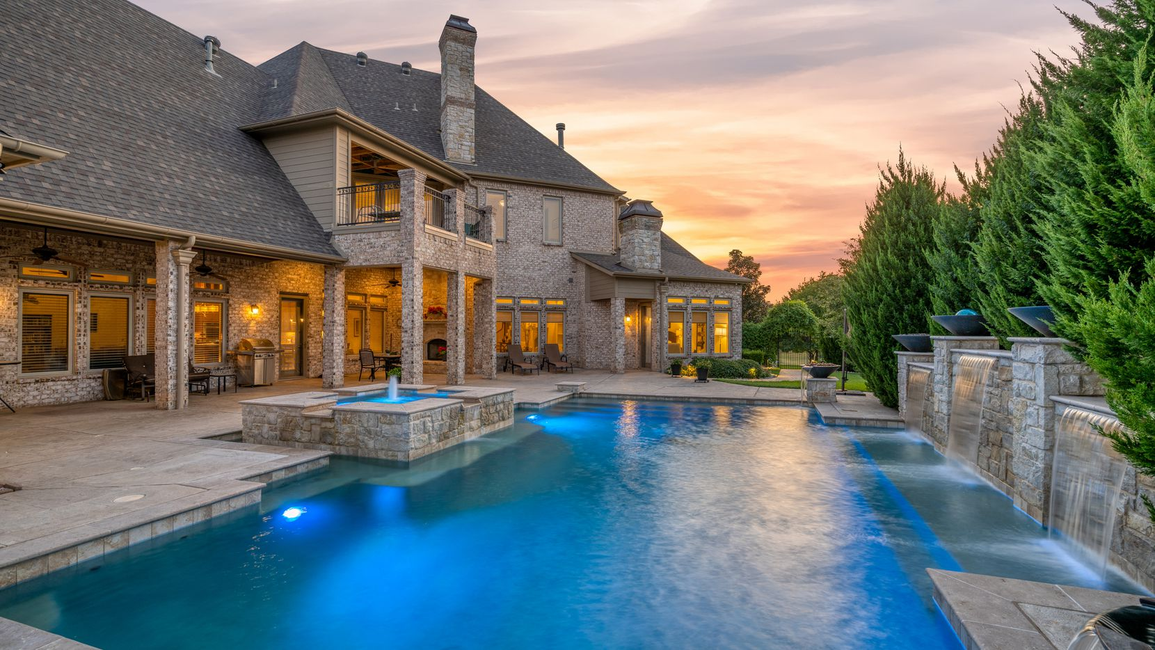 The five-bedroom home at 1701 Live Oak Lane in Southlake has game and media rooms, a pool and a hot tub.