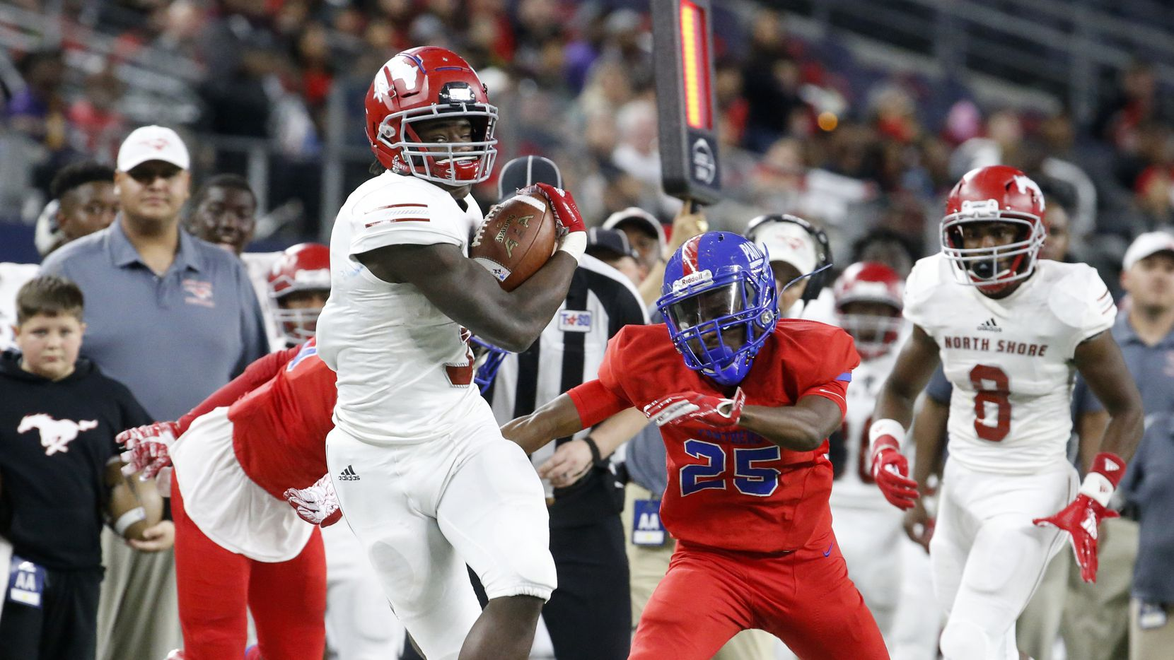 Galena Park North Shore's running back Zach Evans (3) runs past Duncanville's Thailan Scott (25) in the first half of their Class 6A Division I football state championship game at AT&T Stadium in Arlington, Texas on Dec 22, 2018.   (Nathan Hunsinger/The Dallas Morning News)