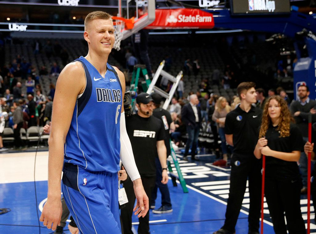 Dallas Mavericks forward Kristaps Porzingis (6) winks as he walks off the court after the Dallas Mavericks defeated the New Orleans Pelicans in overtime 127-123 at American Airlines Center in Dallas on Wednesday, March 4, 2020.