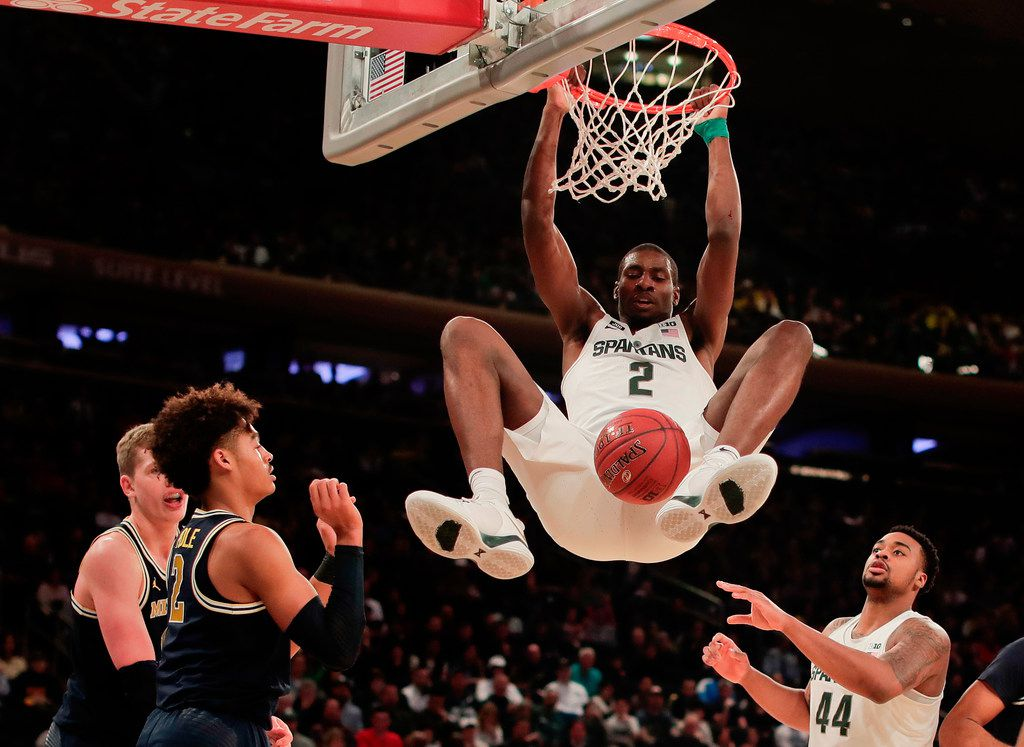 FILE - In this March 3, 2018, file photo, Michigan State forward Jaren Jackson Jr. (2) dunks the ball against Michigan during the first half of an NCAA Big Ten Conference tournament semifinal college basketball game,  in New York. (AP Photo/Julie Jacobson, File)