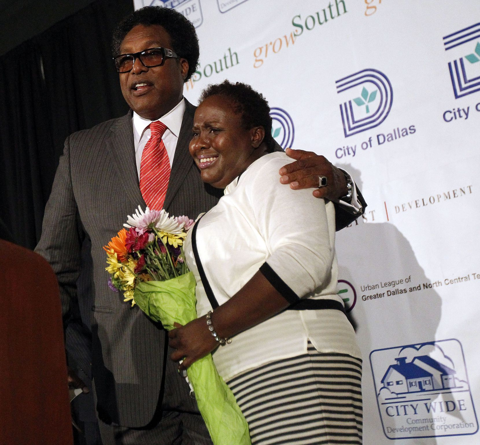 Dwaine Caraway, left, and Carolyn Davis in 2014. The two former Dallas City Council members have been accused of taking numerous bribes from affordable housing developers, including a new case that was filed this week. Davis died in a car crash last year and Caraway is in prison.