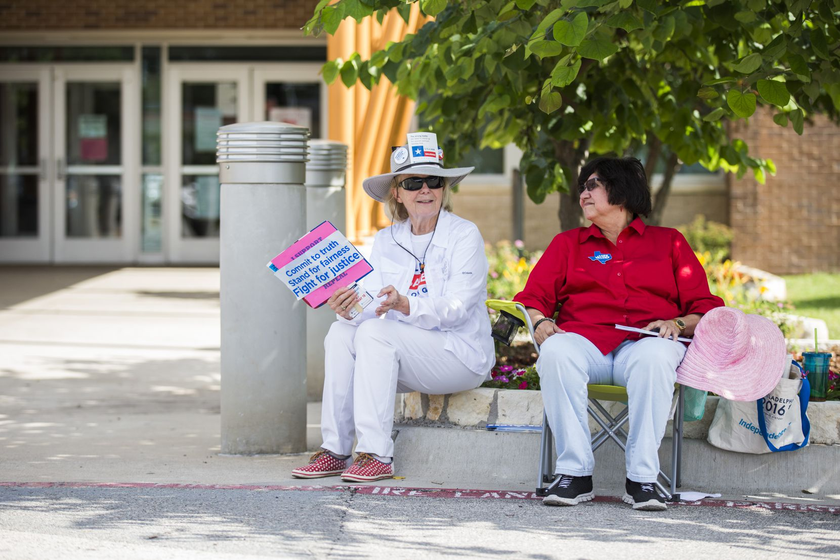 Gubernatorial candidate and former Dallas County Sheriff Lupe Valdez, right, sits with supporter Katherine McGovern outside a primary runoff polling place at Walnut Hill Recreation Center in Dallas earlier on election day.
