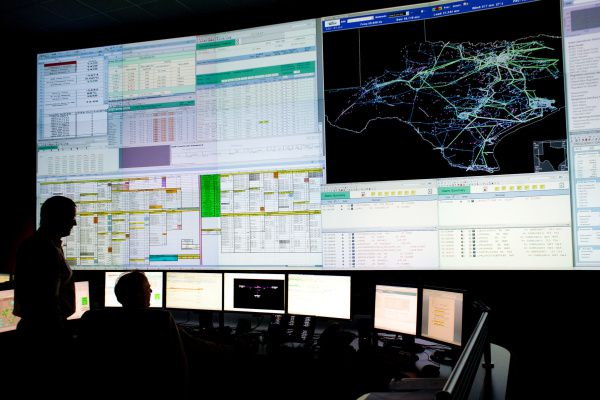 Operators monitor energy transmission at ERCOT's control center in Bastrop. For this summer's first heat wave, ERCOT expects to have enough electricity to meet demand, but it may be close.