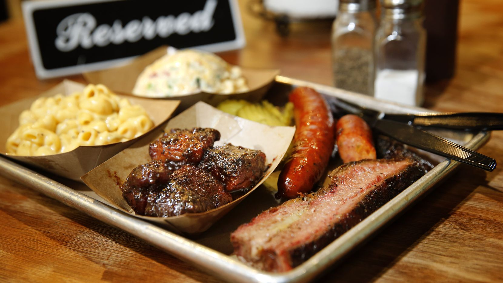A tray full of brisket, burnt ends, sausage, green chile mac & cheese, and twice baked potato salad are pictured at Heim Barbecue in Fort Worth. The restaurant announced it will expand to Dallas in summer 2020.