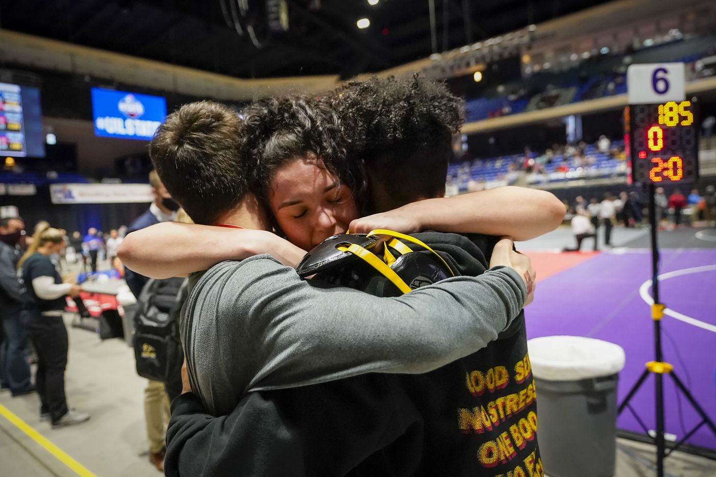 Elizabeth Grabiec of Lewisville The Colony celebrates with teammates after defeating Jillian Wold of Comal Canyon for the 5A girls 165-pound championship during the UIL State Wrestling tournament at the Berry Center on Friday, April 23, 2021, in Cypress, Texas.