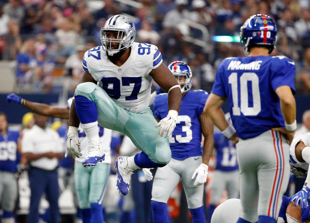 In this Sept. 11, 2016, file photo, former Dallas Cowboys defensive tackle Terrell McClain (97) celebrates tackling New York Giants running back Rashad Jennings as Eli Manning (10) watches during the second half of an NFL football game in Arlington, Texas. (Ron Jenkins / Associated Press)