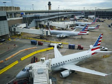 American Eagle planes parked at gates at DFW International Airport.