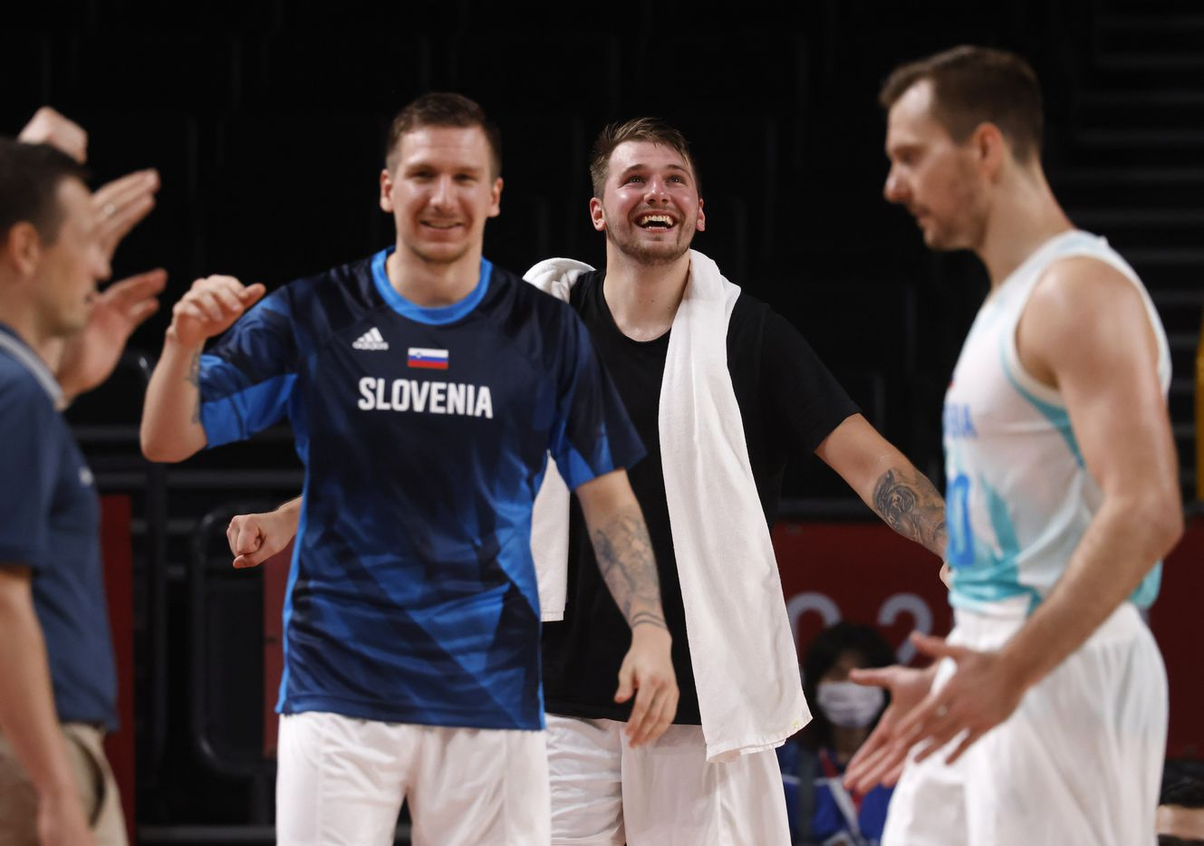 Slovenia's Luka Doncic (77) and teammates celebrate after a made basket in a game against Germany during the second half of play of a quarter final basketball game at the postponed 2020 Tokyo Olympics at Saitama Super Arena, on Tuesday, August 3, 2021, in Saitama, Japan. Slovenia defeated Germany's 94-70. (Vernon Bryant/The Dallas Morning News)