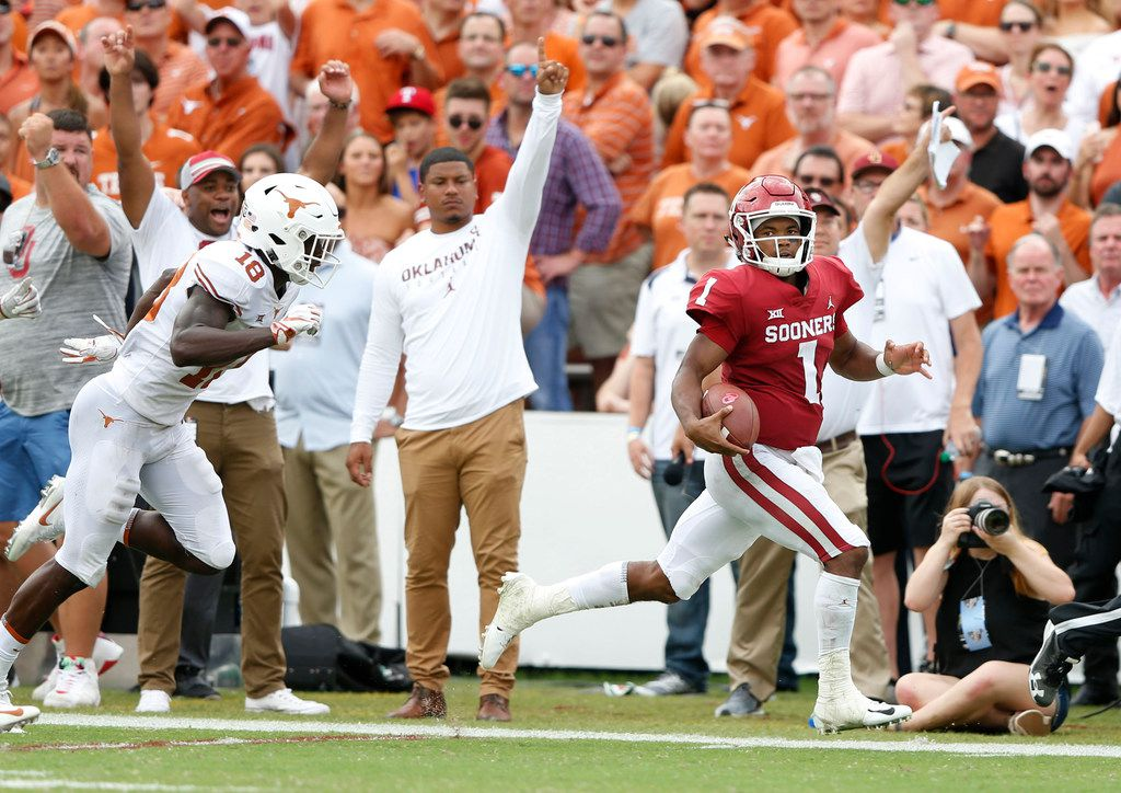 Oklahoma Sooners quarterback Kyler Murray (1) rushes up the field for a 67 yard touchdown as he passes Texas Longhorns defensive back Davante Davis (18) during the second half of play at the Cotton Bowl in Dallas on Saturday, October 6, 2018. Texas Longhorns defeated Oklahoma Sooners 48-45. (Vernon Bryant/The Dallas Morning News)