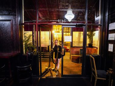 Madeline Doody helps close up at Parliament in Uptown before the midnight deadline for the city of Dallas to close bars in response to the new coronavirus on March 16, 2020. Dallas diners should brace themselves for permanent closures at some establishments.