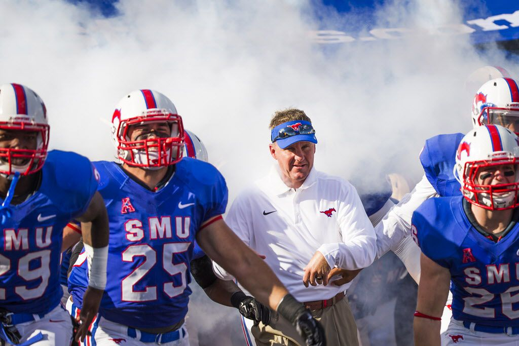 SMU head coach Chad Morris takes the field before an NCAA football game against Baylor at Ford Stadium on Friday, Sept. 4, 2015, in Dallas. (Smiley N. Pool/The Dallas Morning News)