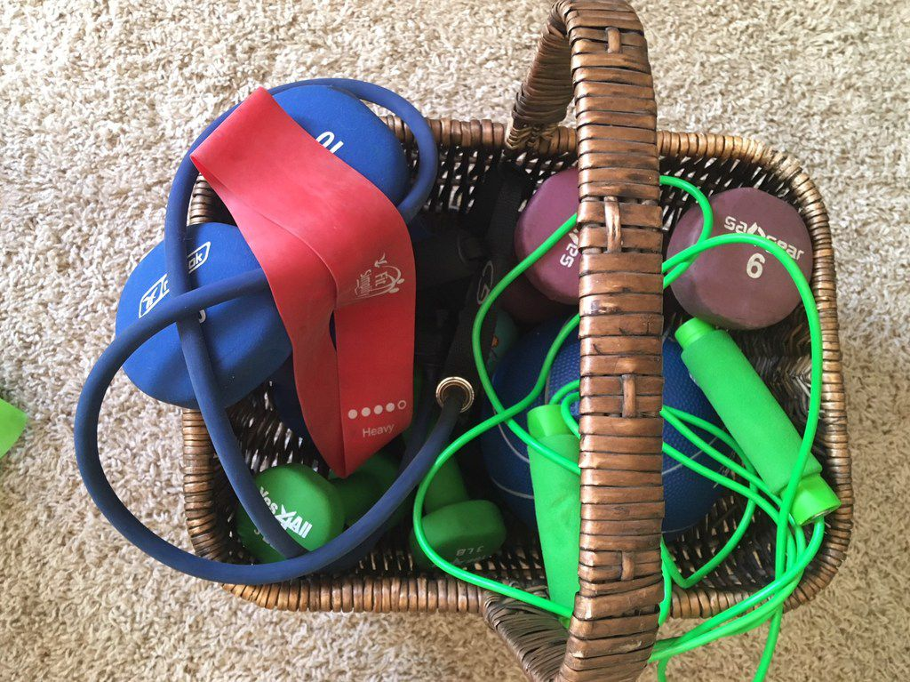 In my den is a basket filled with inexpensive workout stuff. Bet there's room in your den for one, too.