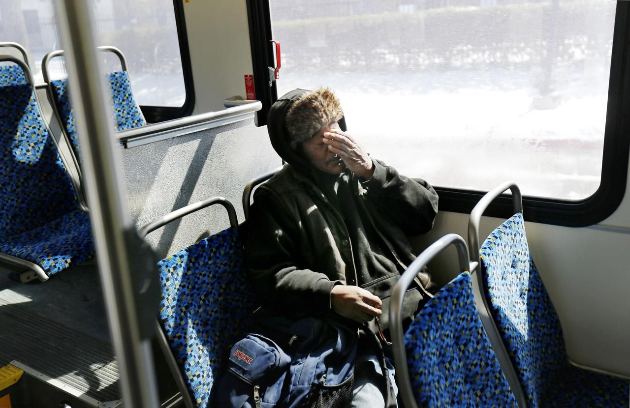 Artis Frank rubs his face during the last leg of his commute on a DART bus.