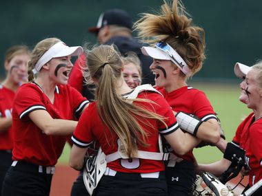 Lovejoy team mates surround shortstop Skylar Rucker (center) after she tagged out a stolen base attempt in the first inning as Lovejoy High School played Wakeland High School in final game of a best of three playoff for District 5A bi-district at McKinney Boyd High School in McKinney on Saturday, May 1, 2021.