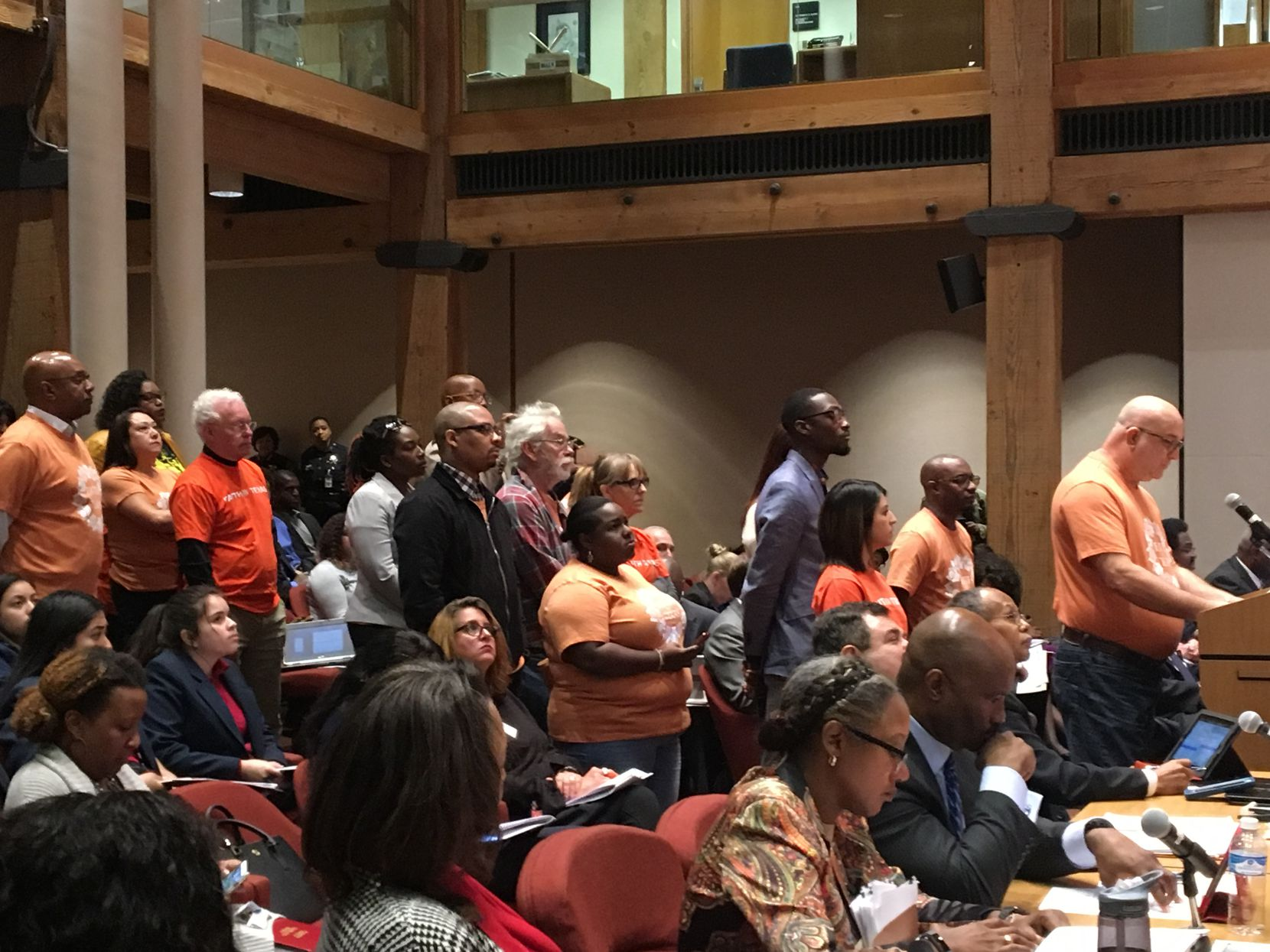 """Howie Darter speaks to the Dallas County Commissioners Court in favor of a marijuana """"cite and release"""" program on Tuesday. Behind him are members of his group, Faith in Texas."""