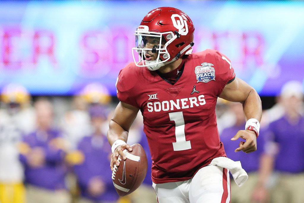 ATLANTA, GEORGIA - DECEMBER 28: Quarterback Jalen Hurts #1 of the Oklahoma Sooners carries the ball against the defense of the LSU Tigers during the Chick-fil-A Peach Bowl at Mercedes-Benz Stadium on December 28, 2019 in Atlanta, Georgia.