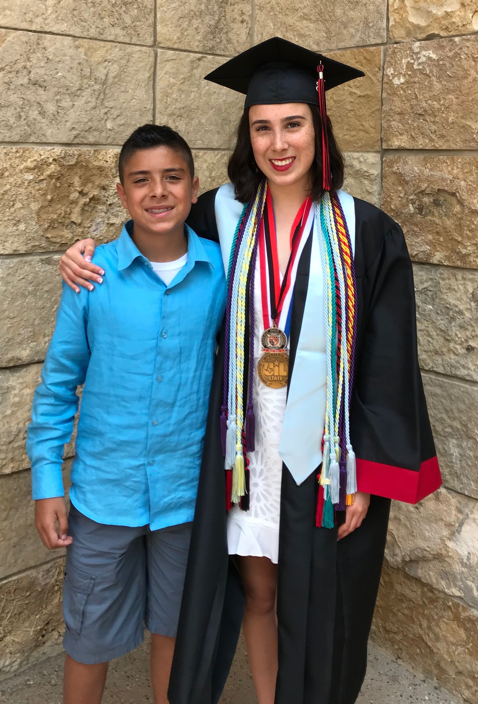 Hannah Ortega poses with her younger brother.