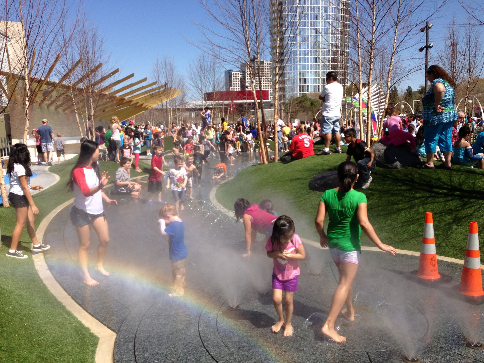 Kids play in the water feature at Klyde Warren Park's Children's Park. Jim Garland designed the park's three existing water features.
