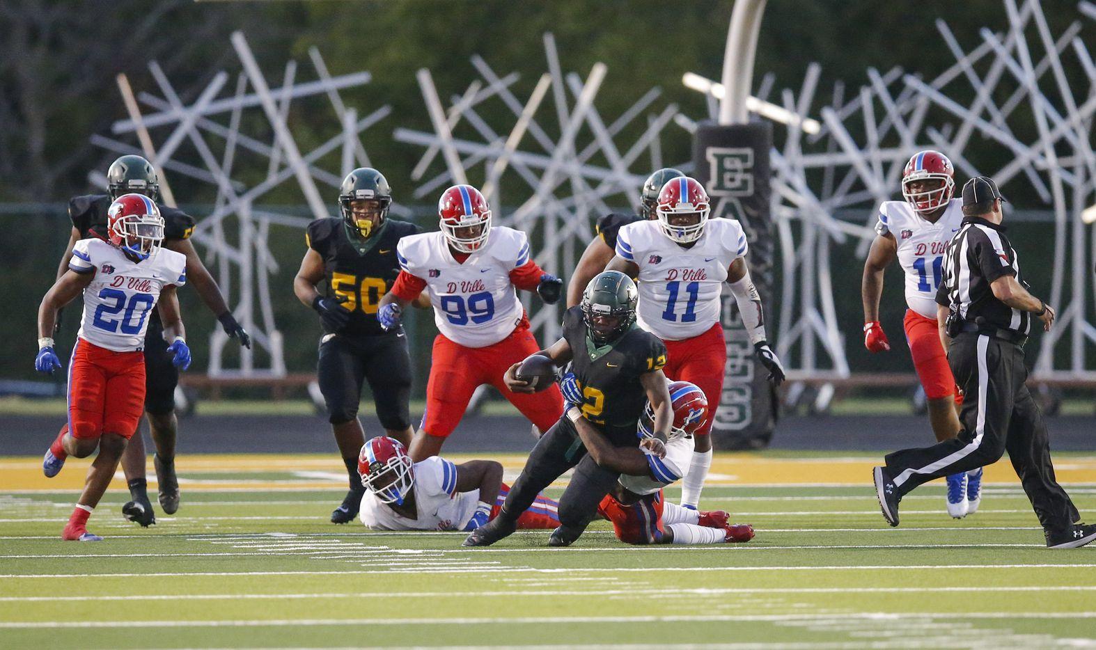 DeSoto senior quarterback Matt Allen (12) is tackled by Duncanville senior linebacker Jordan Crook (2) during the first half of a high school football game at DeSoto High School, Friday, September 17, 2021. (Brandon Wade/Special Contributor)