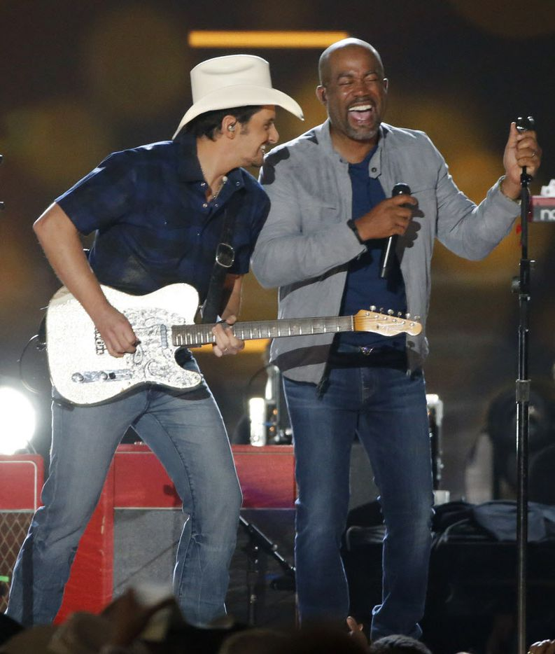 Brad Paisley and Darius Rucker perform during the 2015 Academy of Country Music Awards Sunday, April 19, 2015 at AT&T Stadium in Arlington, Texas.
