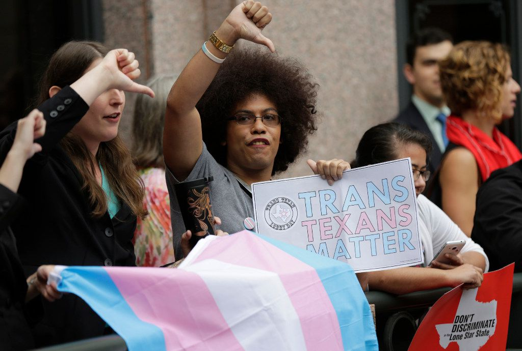 "Nicole Perry joins other members of the transgender community who oppose Senate Bill 6 in a protest at the Texas Capitol as the Senate State Affairs Committee holds hearings on the bill, Tuesday, March 7, 2017, in Austin, Texas. The transgender ""bathroom bill"" would require people to use public bathrooms and restrooms that correspond with the sex on their birth certificate. (AP Photo/Eric Gay)"