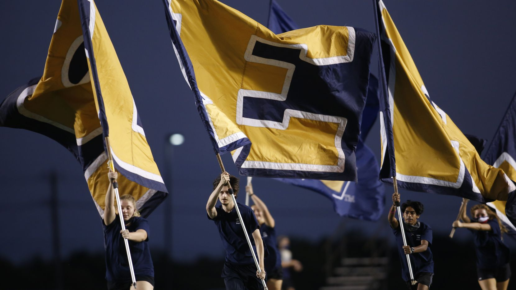 A group of Little Elm Lobos flag wavers take to the spotlight following a first half Lobos touchdown. Little Elm defeated Plano West by the score of 23-9. The two teams played their non-district 6A football game at Lobo Stadium in Little Elm on October 9, 2020.