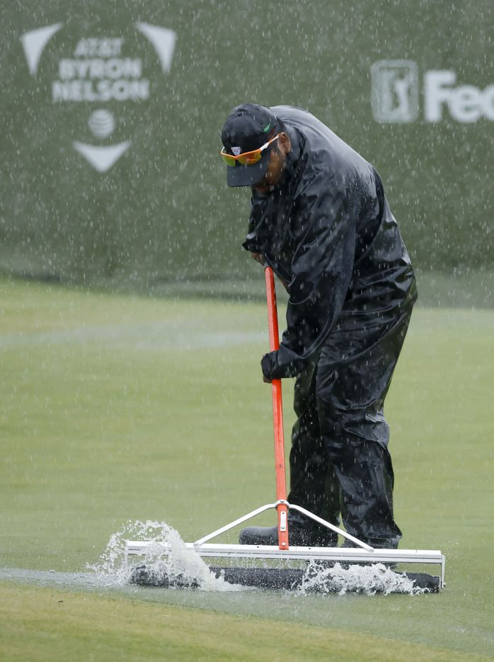 Grounds crew work on getting rainwater off the 17th hole green as rain continues during round 4 of the AT&T Byron Nelson  at TPC Craig Ranch on Saturday, May 16, 2021 in McKinney, Texas. (Vernon Bryant/The Dallas Morning News)