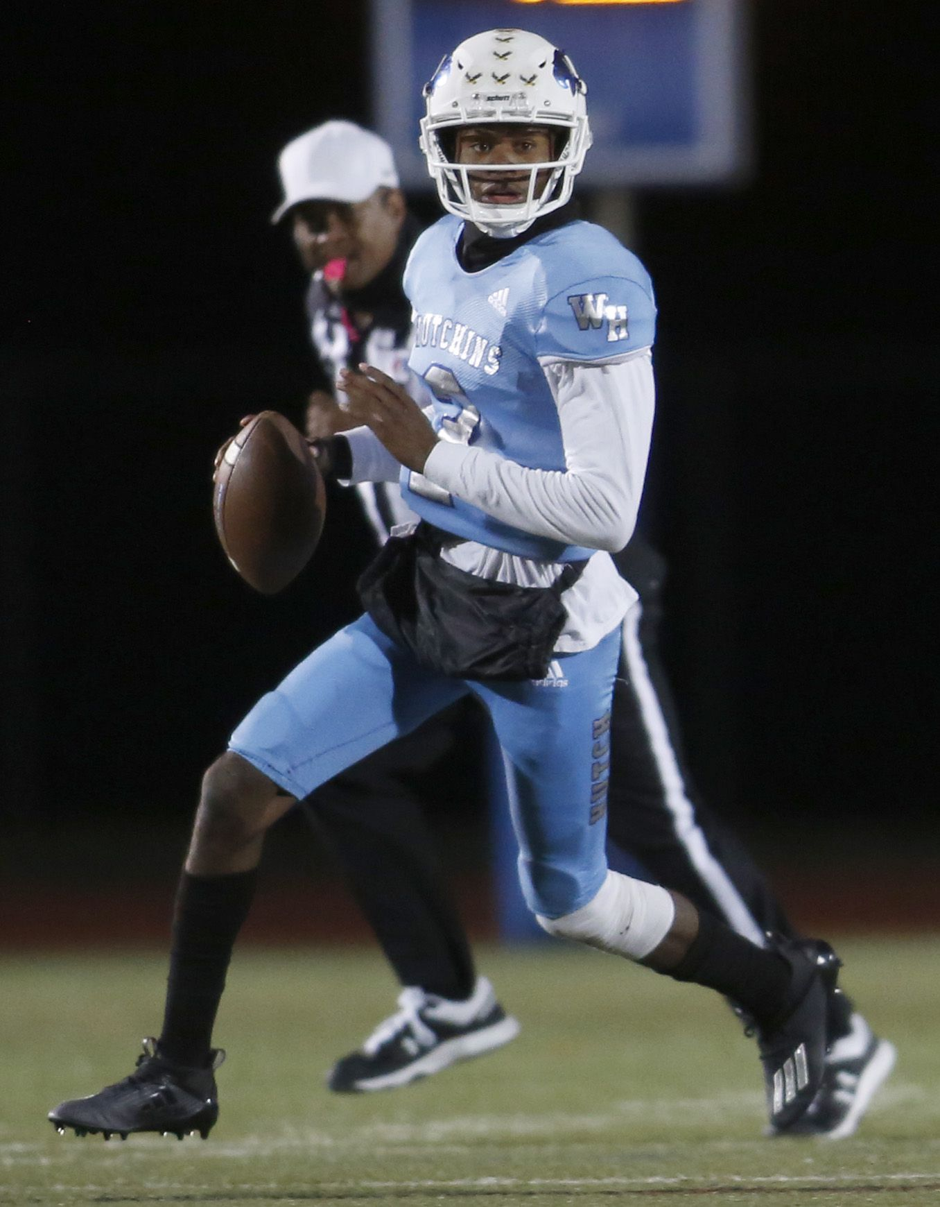 Wilmer Hutchins quarterback Andre Henderson (2) surveys the field as he scrambles during second quarter action against Dallas Carter. The two teams played their District 8-4A Division 1 football game at Wilmer Hutchins High School Stadium in Dallas on October 23, 2020. (Steve Hamm/ Special Contributor)