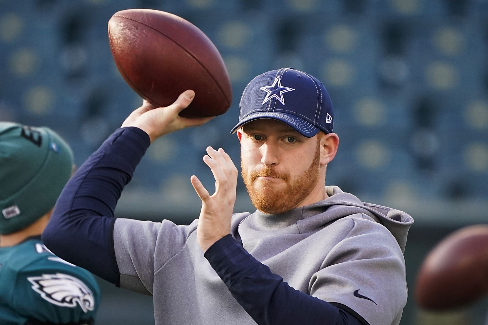 FILE - Cowboys quarterback Cooper Rush warms up before a game against the Eagles at Lincoln Financial Field on Sunday, Dec. 22, 2019, in Philadelphia.