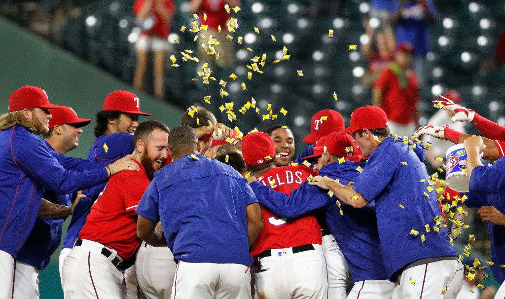 The Rangers celebrate their 3-2 win during the Los Angeles Angels vs. the Texas Rangers major league baseball game at Globe Life Park in Arlington on Monday, September 19, 2016. (Louis DeLuca/The Dallas Morning News)