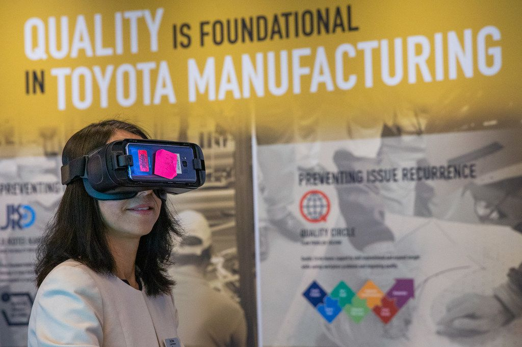 Plano council member Lily Bao experiences an augmented reality exhibit during the grand opening of the Toyota Experience Center at the Toyota North American headquarters in Plano, Texas, on Wednesday, Aug. 7, 2019. The center is the motor company's first and only comprehensive museum space. (Lynda M. Gonzalez/The Dallas Morning News)