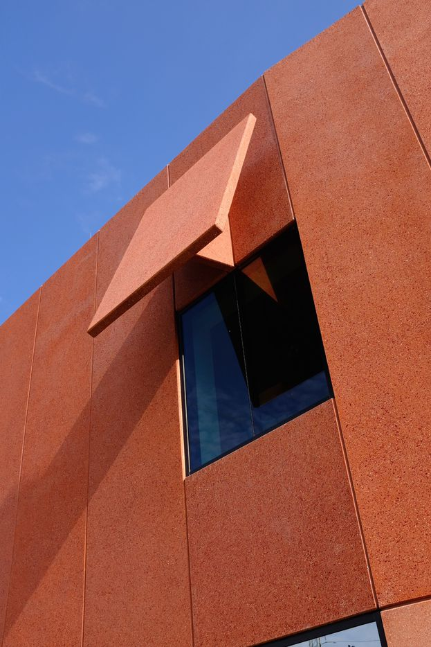 A cantilevered concrete awning shades the interior galleries of the Ruby City complex from the harsh Texas sun.