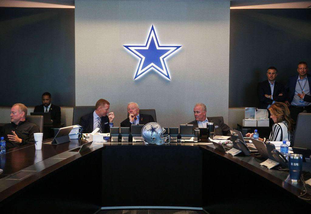 Dallas Cowboys Head Coach Jason Garrett, left, Owner Jerry Jones, and Chief Operating Officer Stephen Jones head the table in The War Room during the first round of the NFL Draft on Thursday, April 25, 2019 at The Star in Frisco, Texas. (Ryan Michalesko/The Dallas Morning News)
