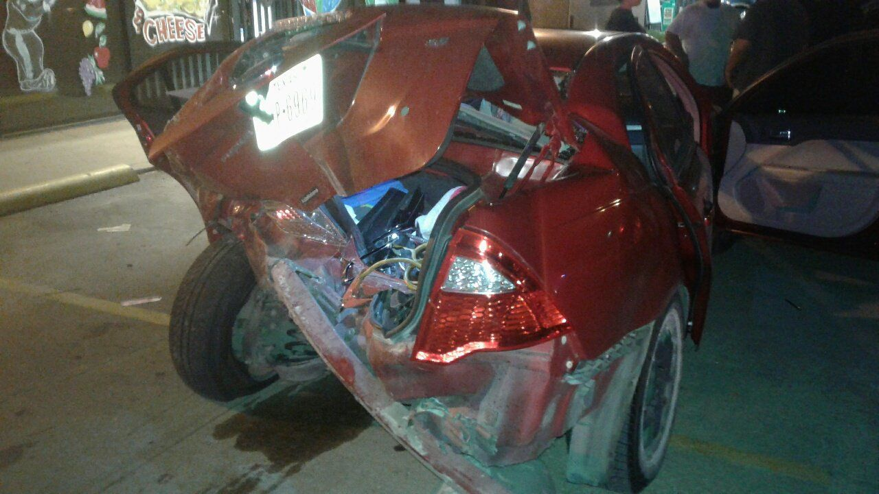 The back of the Ford Focus crumpled in the crash.