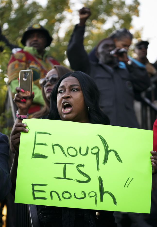 Carol Harrison-Lafayette protests the police shooting of Atatiana Jefferson during a community vigil for Jefferson on Sunday, Oct. 13, 2019, in Fort Worth.