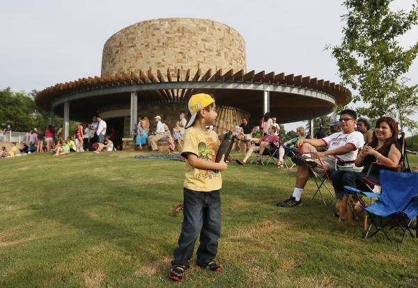 Diego Duarte, 5,of McKinney hangs onto his bottled water at the dedication ceremony for Bonnie Wenk Park in McKinney in 2019. The park will host Jammin' in June Thursday nights this month.