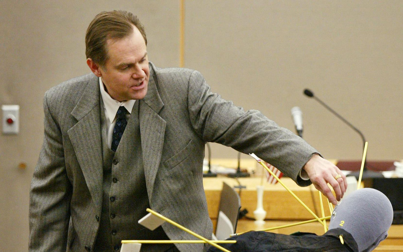"""Dr. Jeffrey Barnard testifies during the January 2002 murder trial of """"Texas 7"""" escapee Donald Newbury about the gunshot wounds that killed Irving police Officer Aubrey Hawkins on Christmas Eve 2000. Newbury was sentenced to death and was executed in February 2015."""