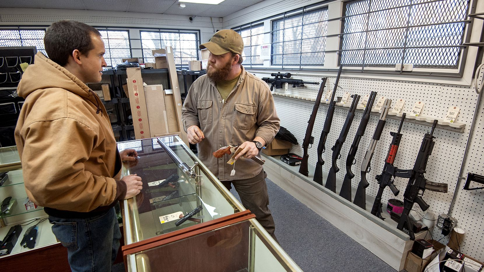 Shane Farren of Ashby Arms, Va., talks with customer Daniel Suter about stock options for his competition rifle.