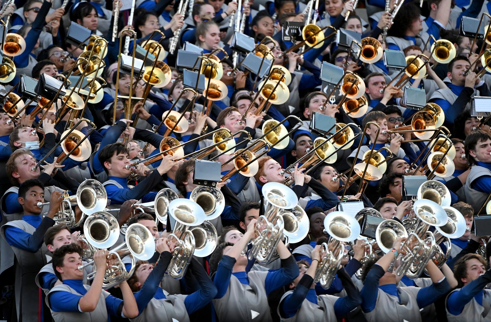 The Allen Escadrille performs in the stands during a high school football game between Plano East and Allen, Friday, Aug. 27, 2021, in Allen, Texas. (Matt Strasen/Special Contributor)