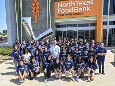 Plano Mayor John Muns (center) is joined by student participants in the 2021 Mayor's Summer Internship Program for a community service day at the North Texas Food Bank.