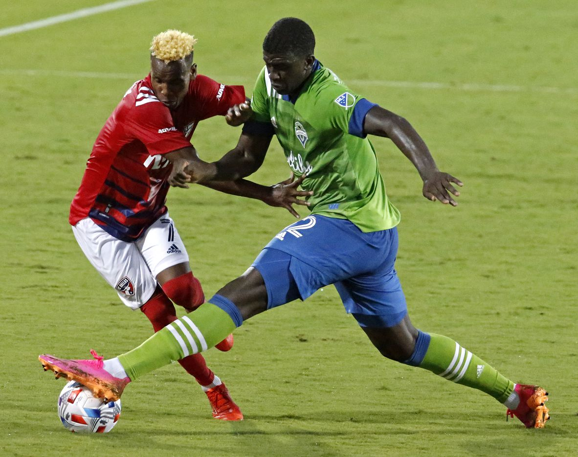 FC Dallas forward Jader Obrian (7) is tripped by Seattle Sounders defender Abdoulaye Cissoko (92) during the first half as FC Dallas hosted the Seattle Sounders at Toyota Stadium in Frisco on Wednesday night, August 18, 2021. (Stewart F. House/Special Contributor)