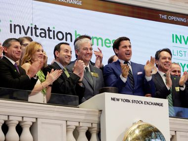 Invitation Homes executives rang the New York Stock Exchange opening bell on Feb. 1, 2017, to mark the company's IPO. (The Associated Press)