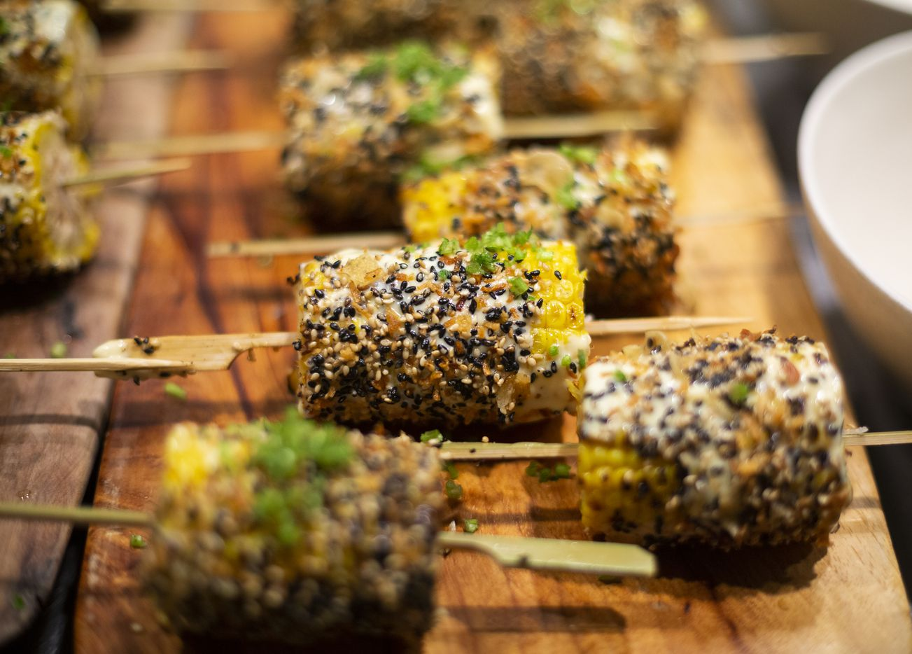 Elotes served as a side during the Thanksgiving dinner at Uchi on Nov. 17, 2019 in Uptown Dallas. Uchi hosted a multi-course dinner with pairings, featuring contemporary Japanese interpretations of traditional Thanksgiving dishes. (Juan Figueroa/ The Dallas Morning News)